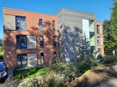 Moderne Neubauwohnung am Eingangstor Eupens inkl. tollem Balkon mit Fernblick sowie Aufzug und Tiefgarage.